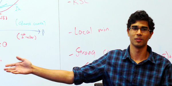 Me, with a whiteboard. Ironically, none of the math written in the background is actually mine.